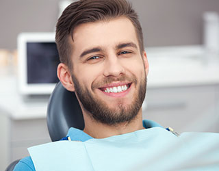 Patient Smiling After Root Canal Treatment